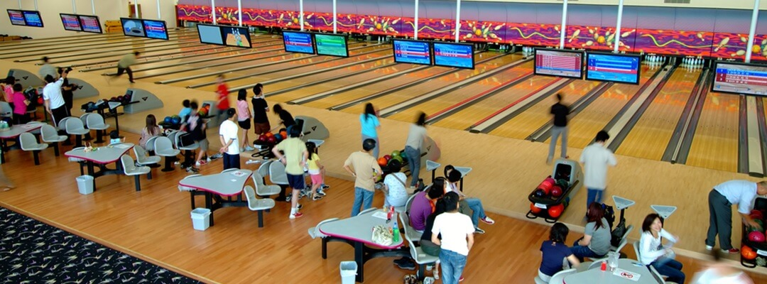 Crowded bowling alley, bowlers speaking lingo