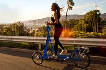 Woman Riding StreetStrider 3i Elliptical Bike Fast