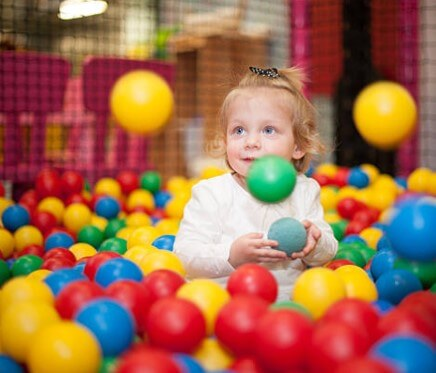 Girl in Ball Pit Bouncey Castle