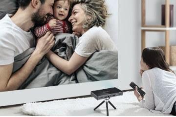Woman watching mini projector