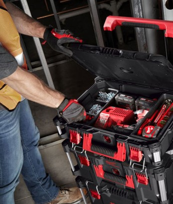 construction worker using stackable tool box on jobsite